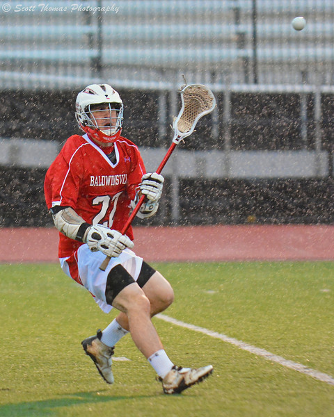 Baldwinsville Bees Matt Zandri (22) passes the lacrosse ball against the Syracuse East Black Knights on Tuesday, April 16, 2013. Baldwinsville Bees won 14-5.