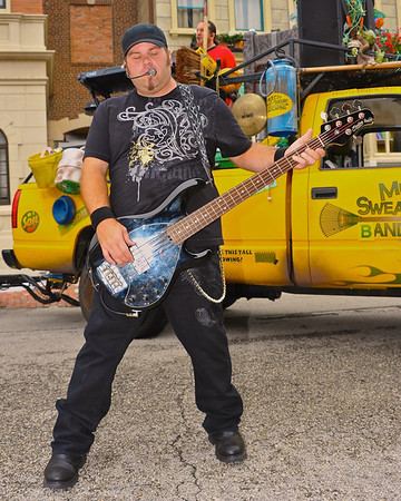 Mulch, Sweat and Shears guitarist performing on the Streets of America in Disney's Hollywood Studios.