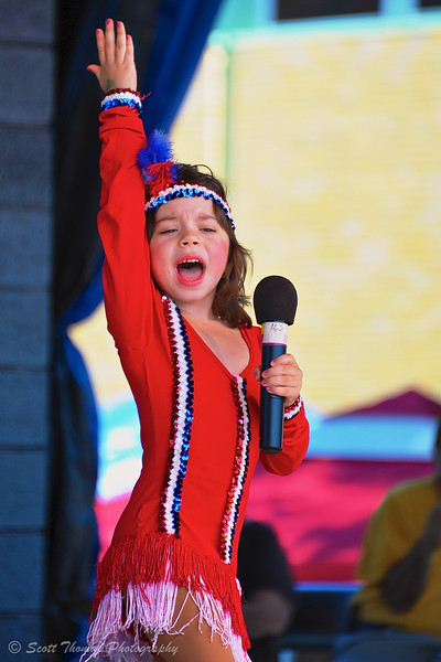 Young singer gives it her all while performing on the Talent Showcase stage at the Great New York State Fair in Syracuse, New York.