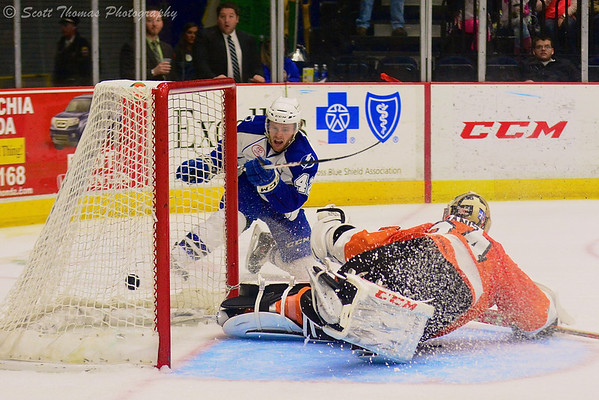 Syracuse Crunch Dana Tyrell (42) puts the puck past Adirondack Phantoms goalie Yann Danis (34) at the War Memorial Arena on Saturday, March 1, 2014. Syracuse won in overtime, 5-4.