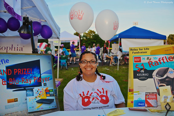 Young woman selling raffle tickets at the Relay For Life event in Baldwinsville, New York.