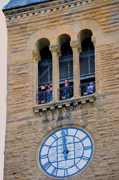 Students looking out from the McGraw Tower on the Cornell University campus in Ithaca, New York after climbing 161 steps.