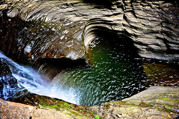 Waterfall flowing into a heart shaped pool looking down from the Gorge Trail in Watkins Glen State Park, Watkins Glen, New York.