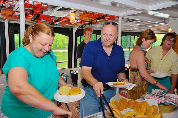 Hungry Alumni partake of the buffet on onboard the Emita II during the Lunch Cruise on the Seneca River.
