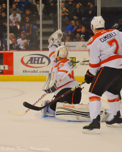 Syracuse Crunch goalie Jeff Deslauriers (43) snags a shot by the Adirondack Phantoms in the Onondaga County War Memorial on Saturday, October 15, 2011 in Syracuse, New York.  Crunch won 6-2.