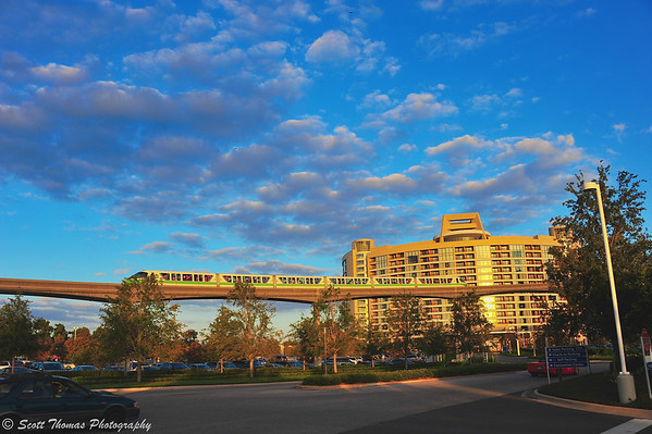 Wide view of Monorail Green passing in front of Bay Lake Tower DVC Resort in Walt Disney World.