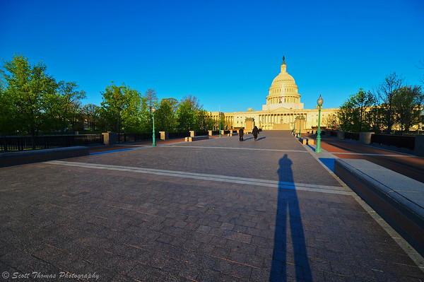 Photographer's shadow is seen in early morning light in front of The Capitol Building in Washington, D.C.