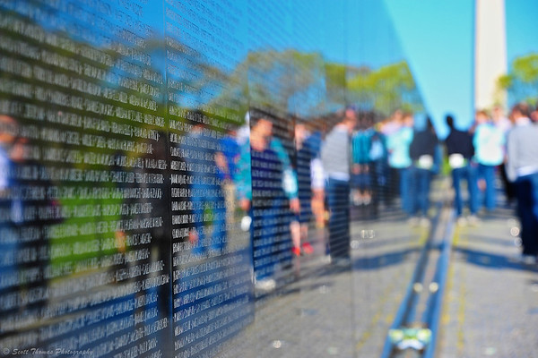 Visitors to the Vietnam Veterans Memorial are reflected in the wall of names on the National Mall in Washington, DC.