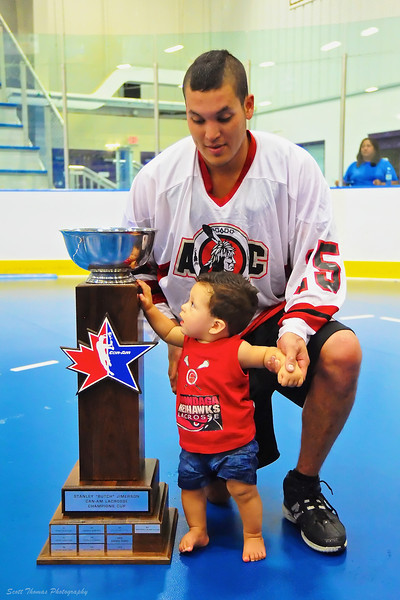 Onondaga Redhawks Grant Bucktooth (15) and son with the Can-Am Cup.