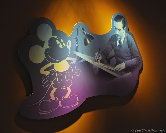 A young Walt Disney at work creating a Mickey Mouse cartoon on a wall display in One Man's Dream exhibit in Disney's Hollywood Studios, Walt Disney World, Orlando, Florida.