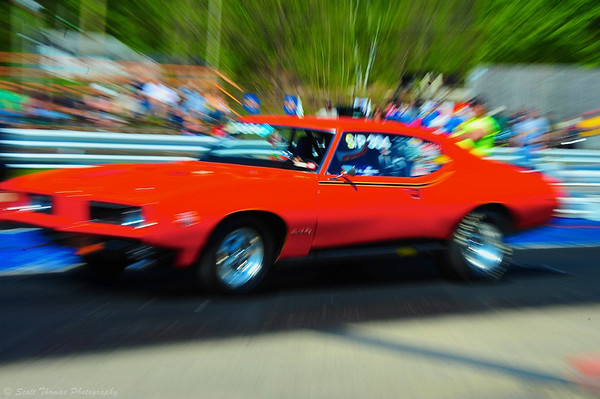 Zoomed photo of an orange GTO at the starting line at the ESTA Safety Park Dragstrip near Cicero, New York.