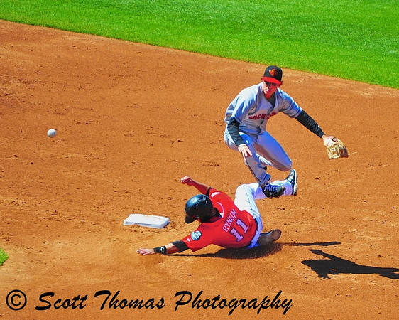 Syracuse Chiefs Seth Bynum (11) slides into 2nd base in an attempt to break up a double play in Alliance Bank Stadium, Syracuse, New York.