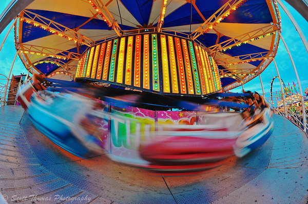 Spinning riders on the Midway of The Great New York State Fair in Syracuse, New York.