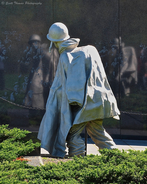 "A soldier reflected in the ""Academy Black"" granite of the Korean War Veterans Memorial in Washington, DC."