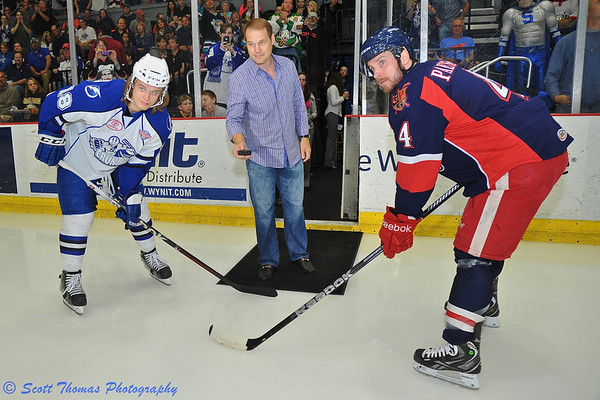 "Former Syracuse Crunch player, Evgeny ""John"" Namestnikov, dropping the puck in between his son, Vladislav Namestnikov (18), and Grand Rapids Griffins Nahtan Paetsh (4) before an American Hockey League (AHL) Calder Cup Finals Playoff game at the Onondaga County War Memorial on Sunday, June 9, 2013."