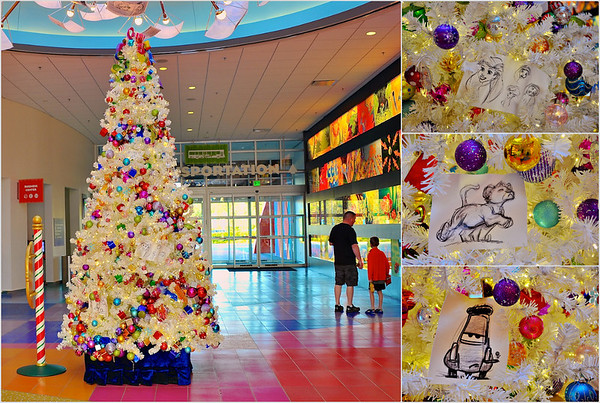 The Christmas tree in the lobby of Disney's Art of Animation featuring animator character sketches of Ariel from The Little Mermaid, young Simba from The Lion King and Guido from Cars.