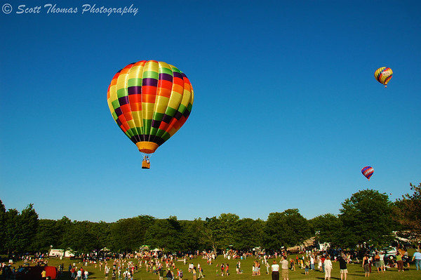 People watch as hot air balloons take to the air at the Jamesville Balloonfest near Syracuse, New York.