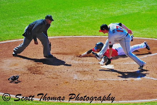 A close play at Home plate...he is safe?