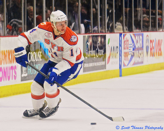 Syracuse Crunch Richard Panik (14) with the puck against the Wilkes-Barre/Scranton Penguins in American Hockey League (AHL) action at the War Memorial Arena on Friday, February 28, 2014. Syracuse won 4-0.