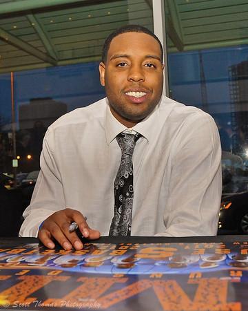 Senior guard Scoop Jardin signing posters at the 41st Annual Syracuse University Basketball Hardwood Club Dinner.