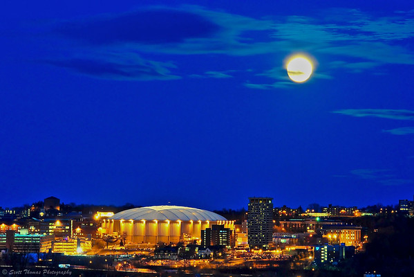 Glowing full Moon over the Carrier Dome on the Syracuse Univeristy campus in Syracuse, New York.