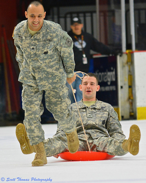 Army guys taking part in a competition during the first intermission of last Friday night's Syracuse Crunch game in the Onondaga County War Memorial.