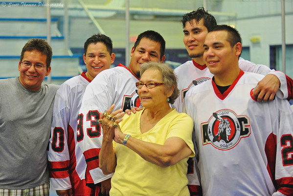 Proud grandmother surrounded by her champion sons at the Onondaga Nation Arena near Nedrow, New York.