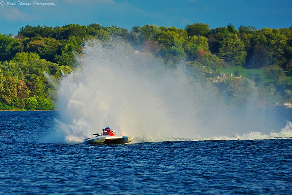 Inboard hydroplane coming around the turn at speed at the 2012 HydroBowl in Geneva, New York.