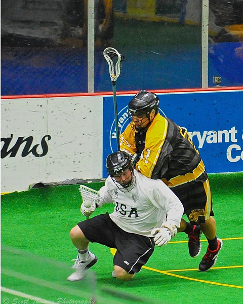 Syracuse Stingers JR Bucktooth (33) checks a NYC Lax All-Stars player at the Onondaga County War Memorial in Syracuse, New York on Thursday, February 21, 2013.