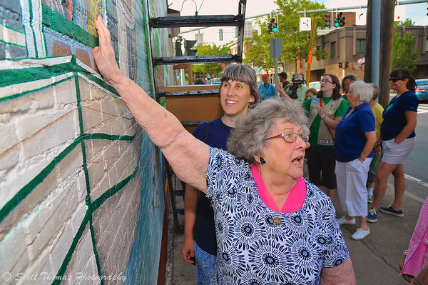 Baldwinsville native, Catherine Rice, 91, pointing out her Grandmother and Aunts shown riding the canal boat on the mural before the dedication ceremony of the new history mural at the 4 Corners in Baldwinsville, New York.