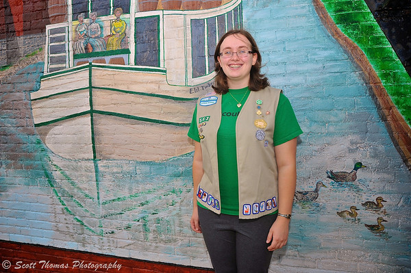 Emily Ekross standing in front of the new history mural she worked for over two years to complete at the 4 Corners in Baldwinsville, New York on Wednesday, August 7, 2013.