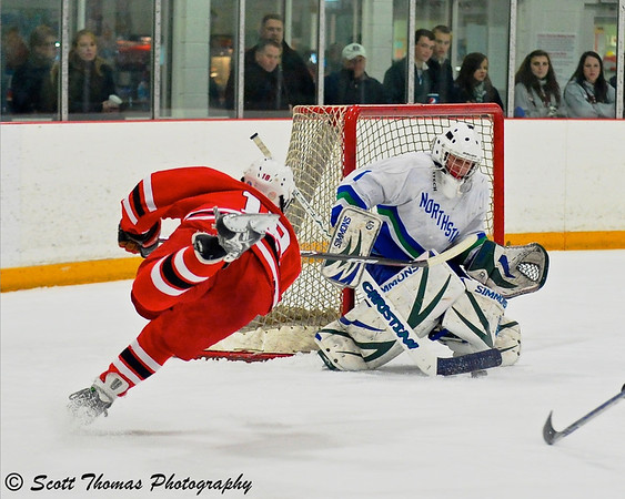 Ice hockey is a fast sport and knowing the game helps a photographer get into position to capture the action.