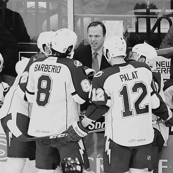 Jon Cooper, head coach of the Syracuse Crunch, spurring his team on before an overtime period.