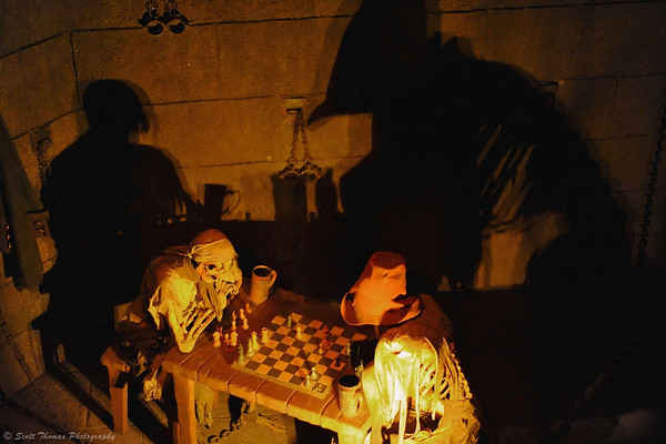 Pirate skeletons playing a never ending game of chess in the queue for Pirates of the Caribbean attracion in the Magic Kingdom.