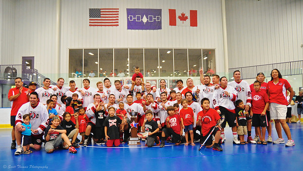 "Onondaga Redhawks posing with the Stanley ""Butch"" Jimerson Can-Am Lacrosse Champions Cup."