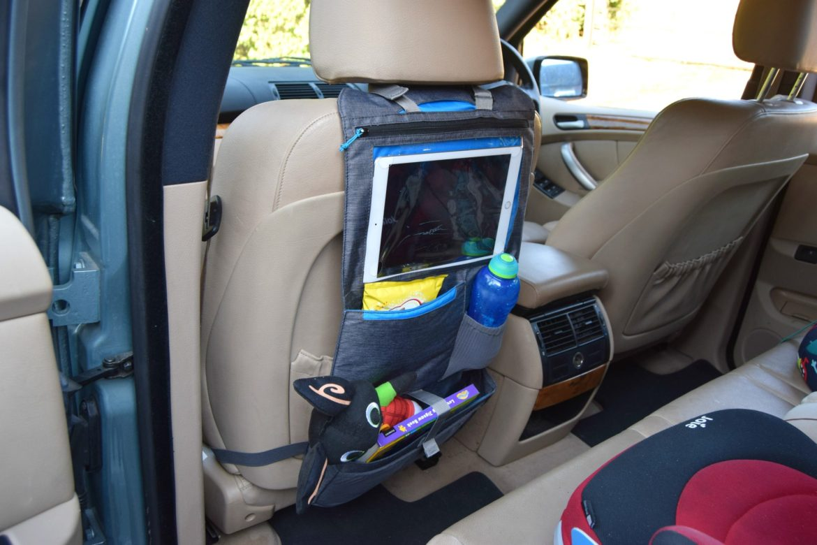 Road trip with kids. A very useful car seat organiser for holding the kids belongings.