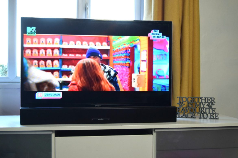 Anker Soundcore Infini Soundbar in front of TV