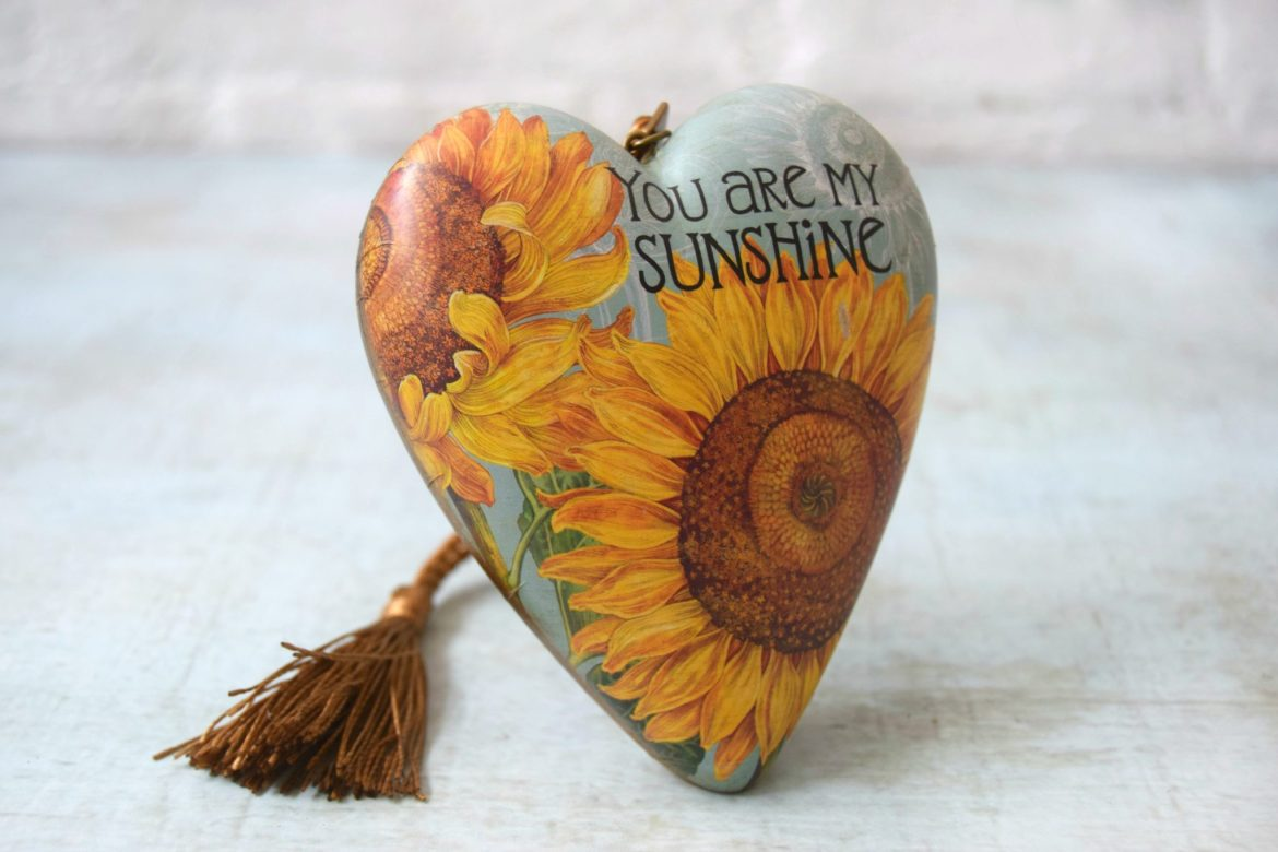 Art hearts range. A heart ornament with you are my sunshine printed on front.