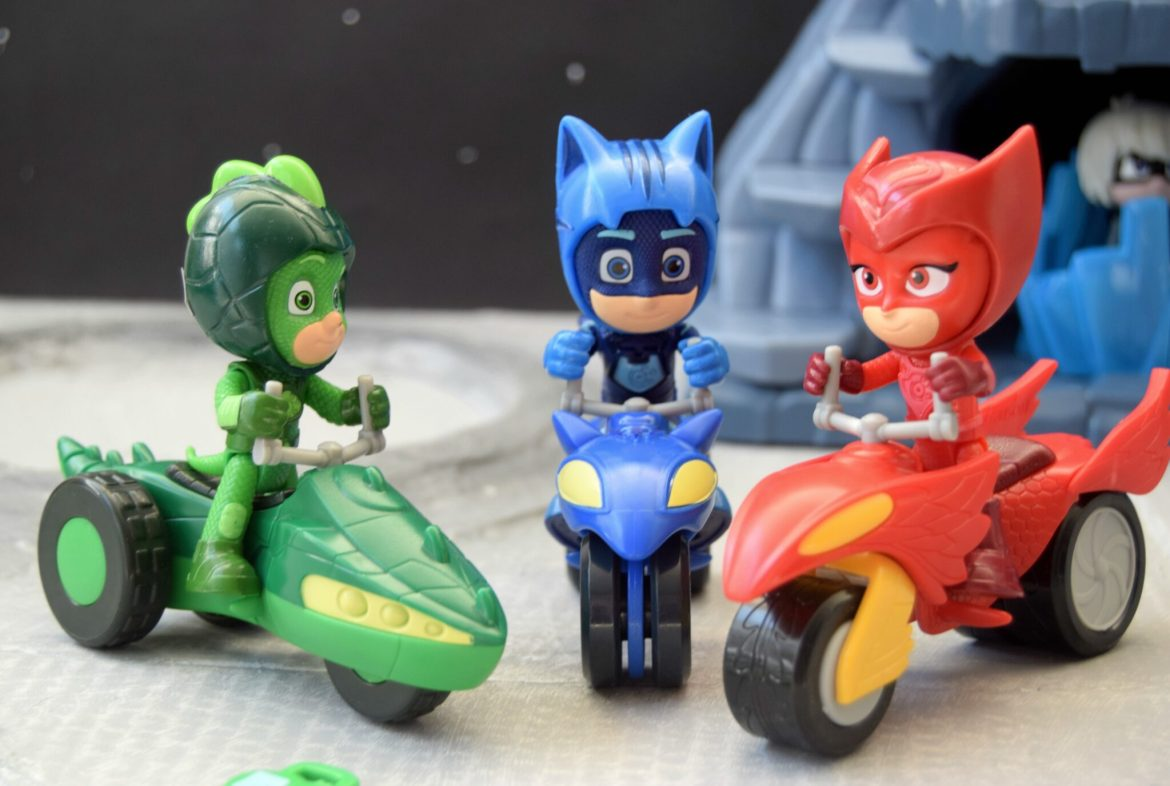 Catboy, Ghecko and Owlette toys riding their rover vehicles.