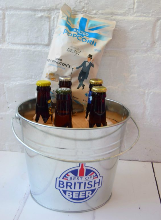 A beer gift. A bucket filled with different beers ad popcorn. Gifts for men that have everything.