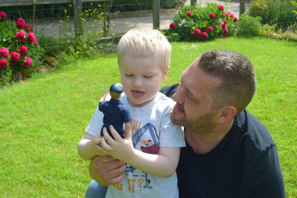 Joben and daddy playing with Action Man Sailor figure