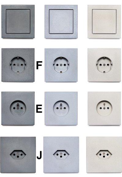 Lichtschakelaars en stopcontacten van beton kleuren