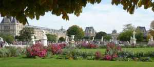 Stautes and flowers at Tuileries garden Paris