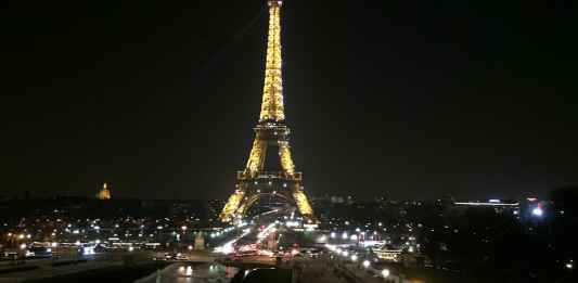 Eiffel Tower by night in Paris