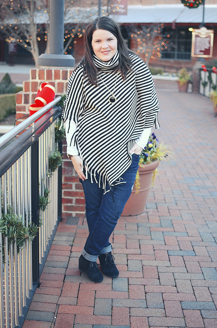Fall & Winter Style: Black and white striped fringe poncho, jeans, TOMS wedges