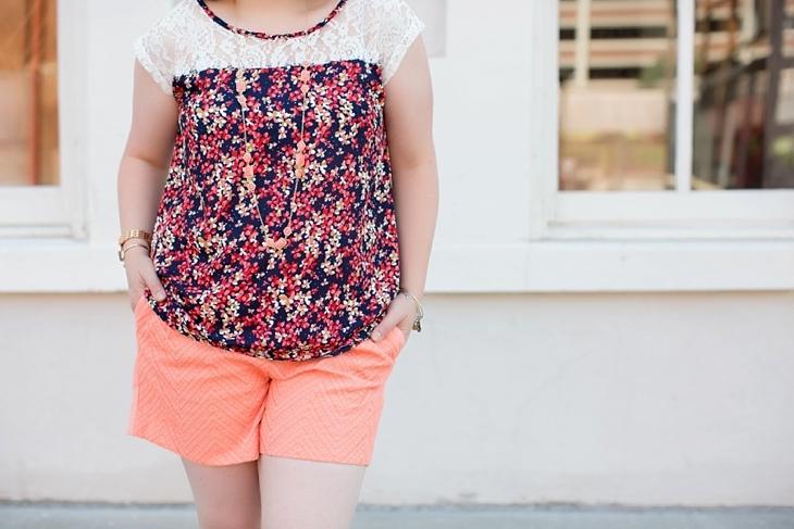 Coral shorts, Sseko sandals, floral top, sunglasses