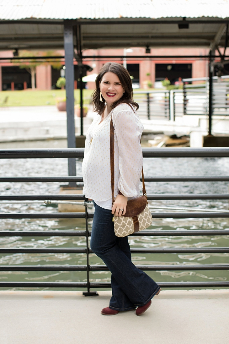 Maternity flare jeans, booties, JOYN bag, Lilly Pulitzer gold and white blouse, Nickel and Suede gold earrings, maternity fashion, style (1)