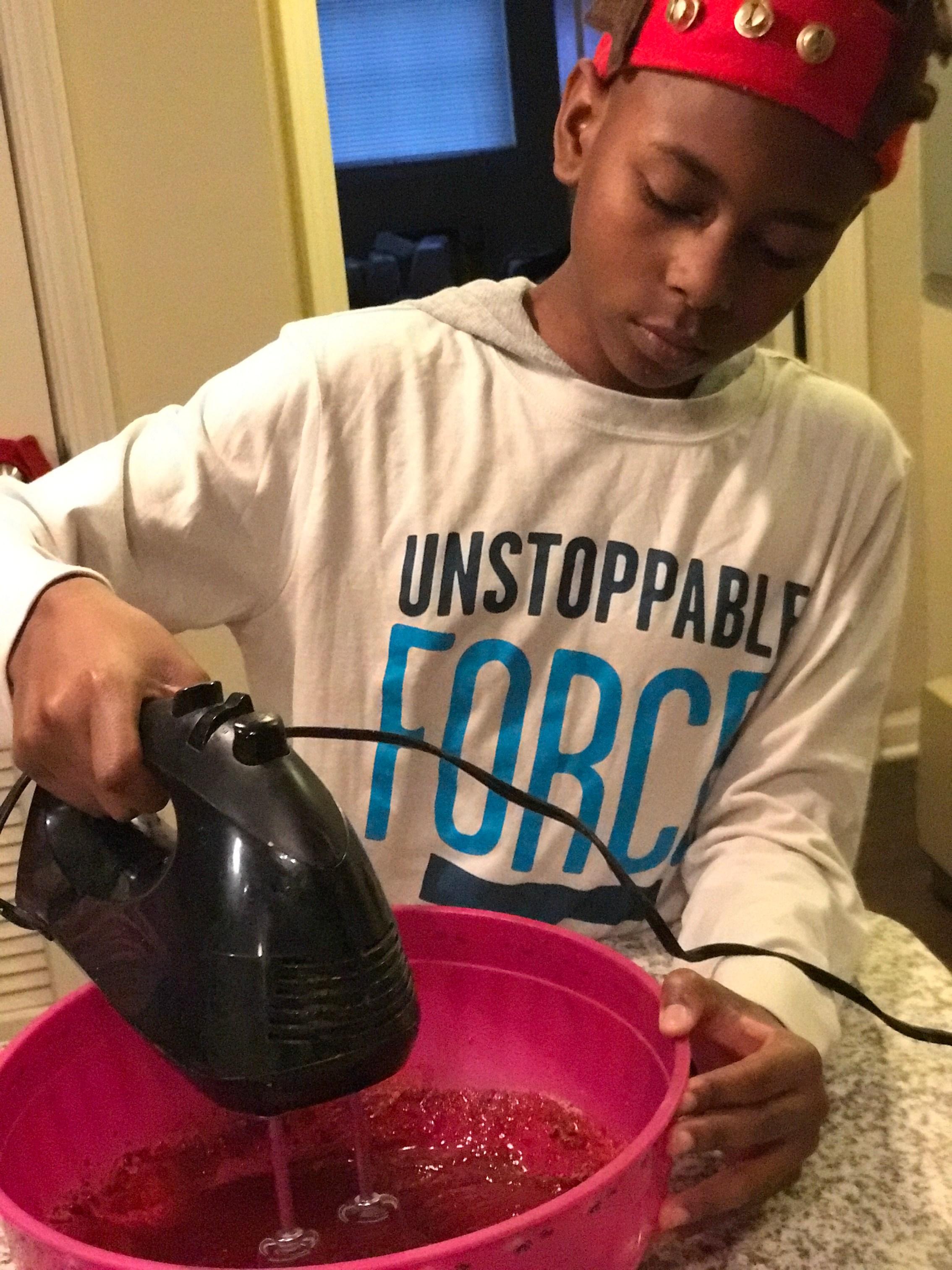 My Godson baking a cake Making memories
