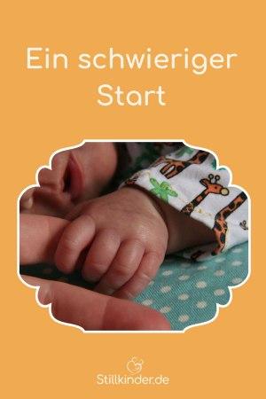 Ein Baby hält einen Erwachsenenfinger