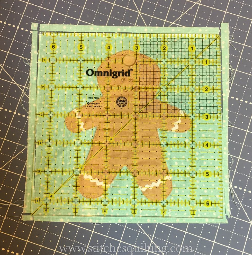 Cozy Christmas Gingerbread Man Ready to be Squared Up with Omnigrid 6.5 inch ruler.